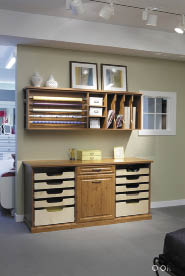 Contain the mess of files, paperwork, hobby supplies and other clutter in a dedicated area. Shown here: A craft and wrapping station in a knotty timber wood grain finish from ORG. Photo courtesy of Alaska Premier Closets.